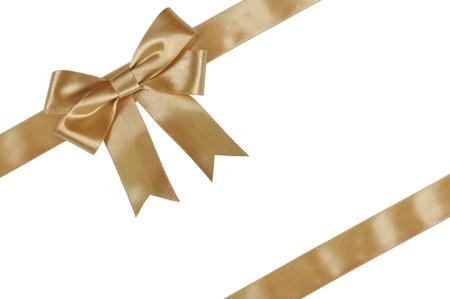 fiocco oro: Nastro d'oro con fiocco isolato su sfondo bianco. Archivio Fotografico