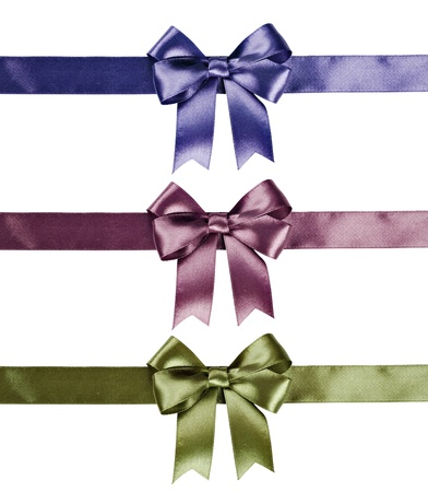 Set of ribbon bows - green, pink, violet on white background. Clipping path for each bow included. photo