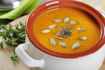 potage: Pumpkin cream soup with pumpkin seeds and dried herbs