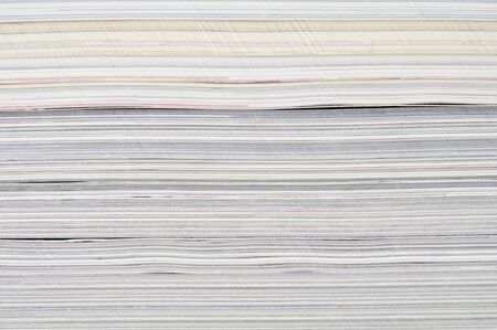 writing materials: Background of a pile of old magazines closeup Stock Photo