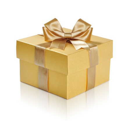 Golden gift box with golden ribbon over white background. Clipping path included. Stockfoto