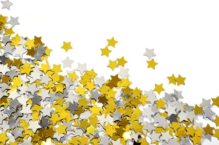 confetti background: Mix of golden and silver star confetti on white background