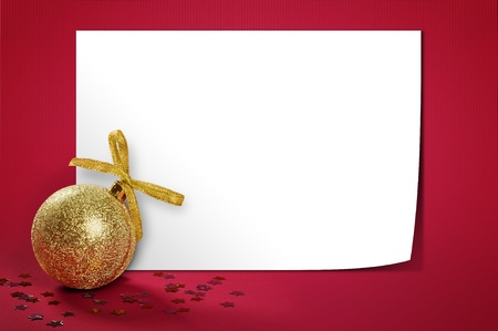 paper curl: Christmas gold glitter bauble  over red background with blank  paper. Stock Photo