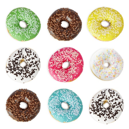 Sweet colorful donuts isolated on white background Stock Photo - 16725102