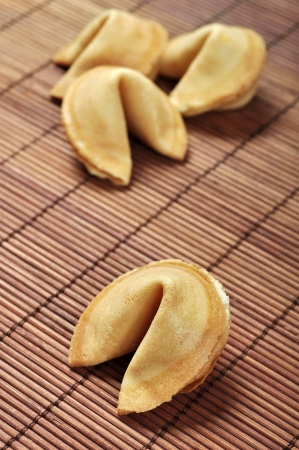 fortune telling: Some Fortune Cookies on bamboo placemat