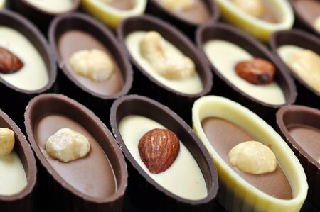 Assorted chocolate candies with different nuts, closeup Stock Photo - 16820507