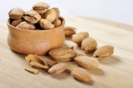 fissures: Some almond in a wooden bowl closeup