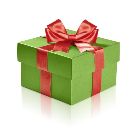 Green gift box with red ribbon over white background. Clipping path included. photo