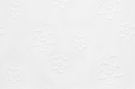 Closeup of toilet paper with floral pattern photo