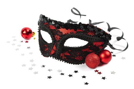 carnival red mask with silver confetti on white background photo