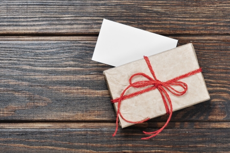 Vintage gift box with red ribbon on wooden background Stock Photo - 17306531
