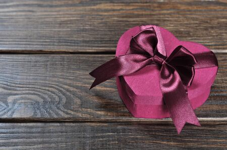 Heart shaped pink Valentines Day gift box on wooden background Stock Photo - 17306505