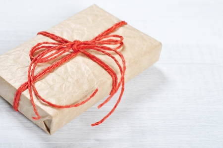 Vintage gift box with red ribbon on wooden background closeup Stock Photo - 17360607