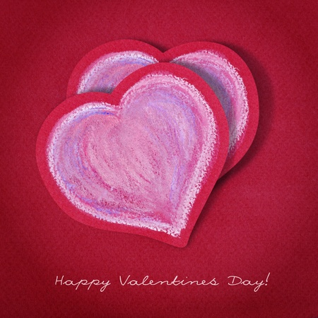 Two hearts drawn in chalk on red paper. Valentines Day postcard. photo
