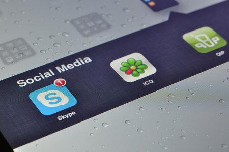 icq: Kiev, Ukraine - Jan 12, 2013: Apple Ipad screen with social media applications of Skype, QIP, ICQ,