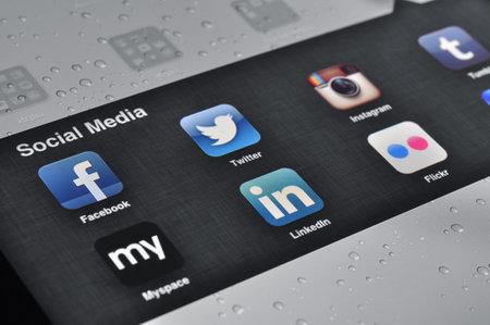 linkedin: Kiev, Ukraine - Jan 12, 2013: Apple Ipad screen with social media applications of Facebook, Twitter, Linkedin, Myspace, Instagram, Flicr, Tumblr Editorial