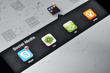 icq: Kiev, Ukraine - Jan 12, 2013: Apple Ipad screen with social media applications of Skype, Qip, ICQ, ooVoo,