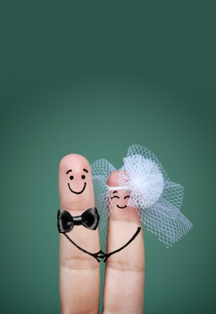 finger bow: Two happy fingers decorated as bride and groom with veil and bow tie
