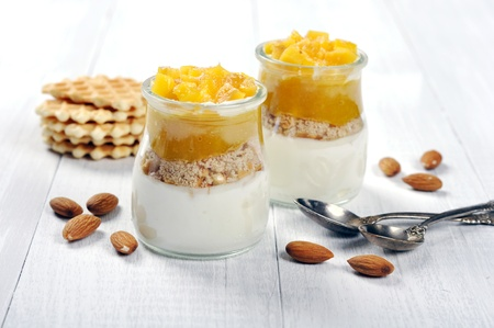 panna cotta: Fruit dessert with mango and amond on wooden background