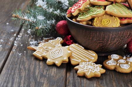 Christmas Ginger and Honey cookies on wooden background. Star, fir tree, heart, bear shape. photo