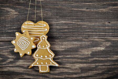 Christmas Ginger and Honey cookies on wooden background photo