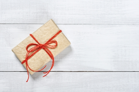 Vintage gift box with red ribbon on wooden background Stock Photo - 17775572