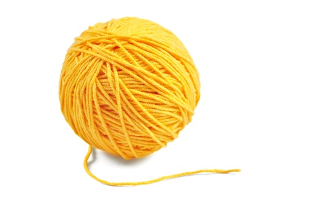 cotton ball: Yellow wool yarn ball isolated on white background