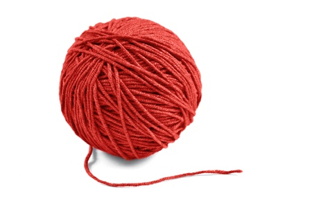 needlecraft product: Red wool yarn ball isolated on white background