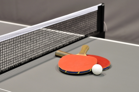 Equipment for table tennis - racket, ball, table closeup  photo