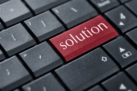 Black keyboard with red solution button on enter key closeup Stock Photo - 18289401