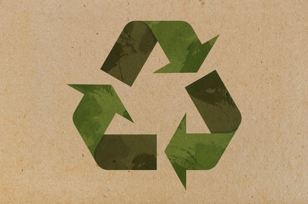 Recycle icon on cardboard  background closeup photo