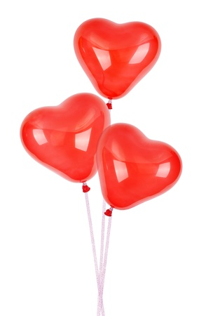 Three red heart balloons isolated on white background photo