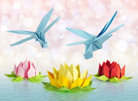 origami blue dragonfly over flowers lotus over white background photo