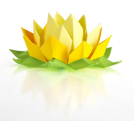 Yellow lotus origami isolated on a white background photo