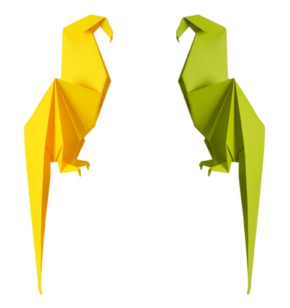 origami bird: origami parrot isolated on a white background