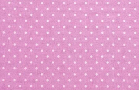 polka dot fabric: rosa polka dot tessuto primo piano. Pu� utilizzare come sfondo Archivio Fotografico