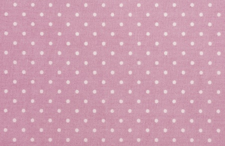 pink polka dot fabric closeup. May use as background photo