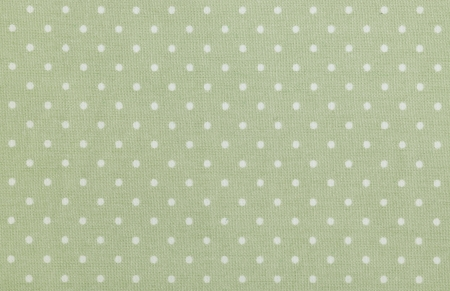 green polka dot fabric closeup. May use as background photo