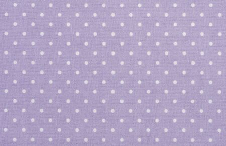 violet polka dot fabric closeup. May use as background photo