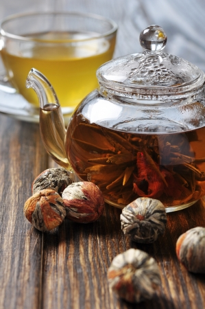 bolls: Glass teapot and cup with chinease green tea on wooden background