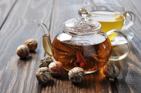 bolls: Chinese green tea with lychee in teapot on wooden background Stock Photo