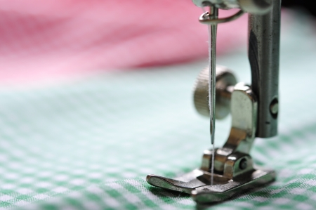 seam: Part of sewing machine and checkered fabric closeup Stock Photo