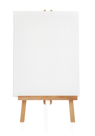 wooden easel with blank canvas isolated on white background photo