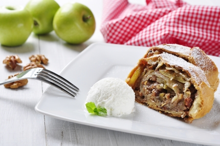 apple strudel on a dish with fresh apples and nuts photo