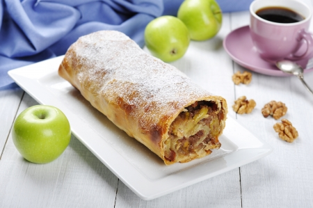 apple strudel on a dish with fresh apples and cup of coffee photo