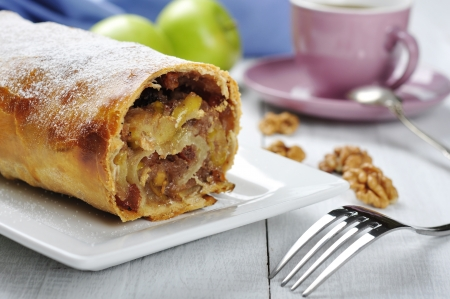 strudel: apple strudel on a dish with fresh apples and cup of coffee