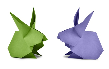 Origami. Paper rabbits isolated on white background photo