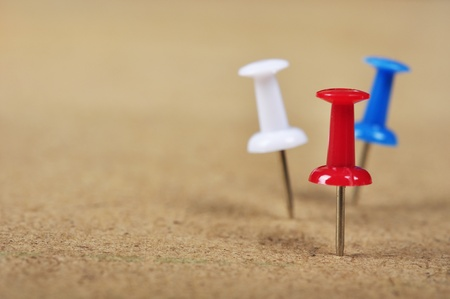 Pushpins on wooden background closeup. Small shallow DOF photo
