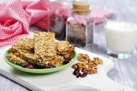 Muesli Bars on plate with nuts and dried fruits Stock Photo - 19427632