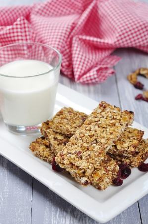 cereal bar: Muesli Bars on plate with nuts and dried fruits